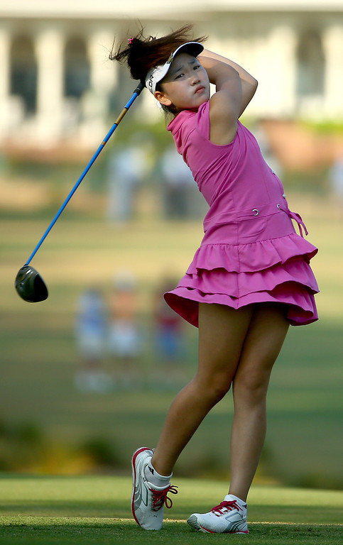 . Eleven-year old Amateur Lucy Li of the United States hits a tee shot during a practice round prior to the start of the 69th U.S. Women\'s Open at Pinehurst Resort & Country Club, Course No. 2 on June 18, 2014 in Pinehurst, North Carolina.  (Photo by Streeter Lecka/Getty Images)