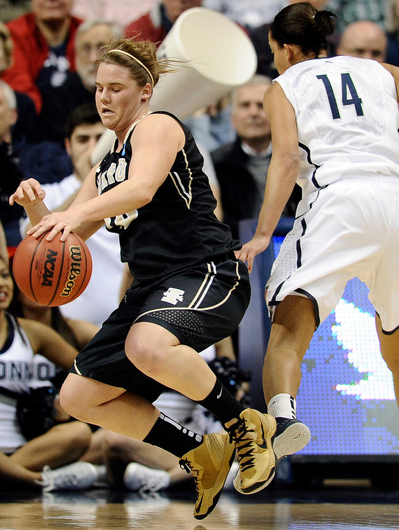 . Idaho\'s Stacey Barr, left, is fouled by Connecticut\'s Bria Hartley, right, in the first half of a first-round game in the women\'s NCAA college basketball tournament in Storrs, Conn., Saturday, March 23, 2013.  Connecticut won 105-37. (AP Photo/Jessica Hill)