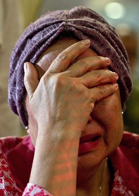 """. Akmar Binti Mohd Noor, 67, whose sister was onboard Malaysia Airlines flight MH17 from Amsterdam cries outside the family holding area at the Kuala Lumpur International Airport in Sepang on July 18, 2014. A Malaysian airliner carrying 295 people from Amsterdam to Kuala Lumpur crashed on July 17 in rebel-held east Ukraine, as Kiev said the jet was shot down in a \""""terrorist\"""" attack. Ukraine\'s government and pro-Russian insurgents traded blame for the disaster, with comments attributed to a rebel commander suggesting his men may have downed Malaysia Airlines flight MH17 by mistake, believing it was a Ukrainian army transport plane. AFP PHOTO/ MANAN VATSYAYANA/AFP/Getty Images"""