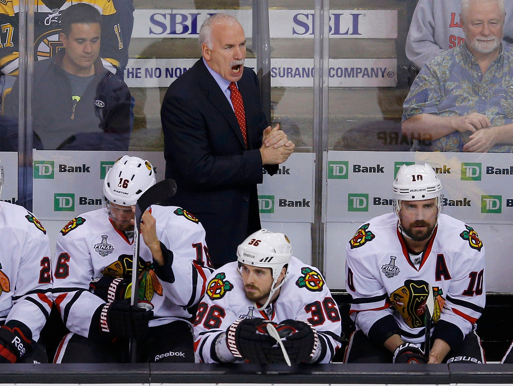 . Chicago Blackhawks head coach Joel Quenneville yells directions to his players during the first period against the Boston Bruins in Game 4 of their NHL Stanley Cup Finals hockey series in Boston, Massachusetts, June 19, 2013. REUTERS/Brian Snyder