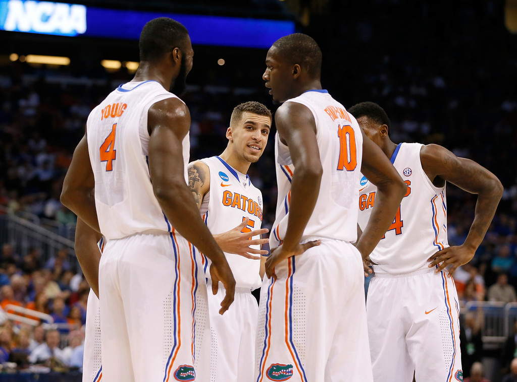 . ORLANDO, FL - MARCH 20:  Scottie Wilbekin #5 of the Florida Gators talks with his teammates in the first half against the Albany Great Danes during the second round of the 2014 NCAA Men\'s Basketball Tournament at Amway Center on March 20, 2014 in Orlando, Florida.  (Photo by Kevin C. Cox/Getty Images)