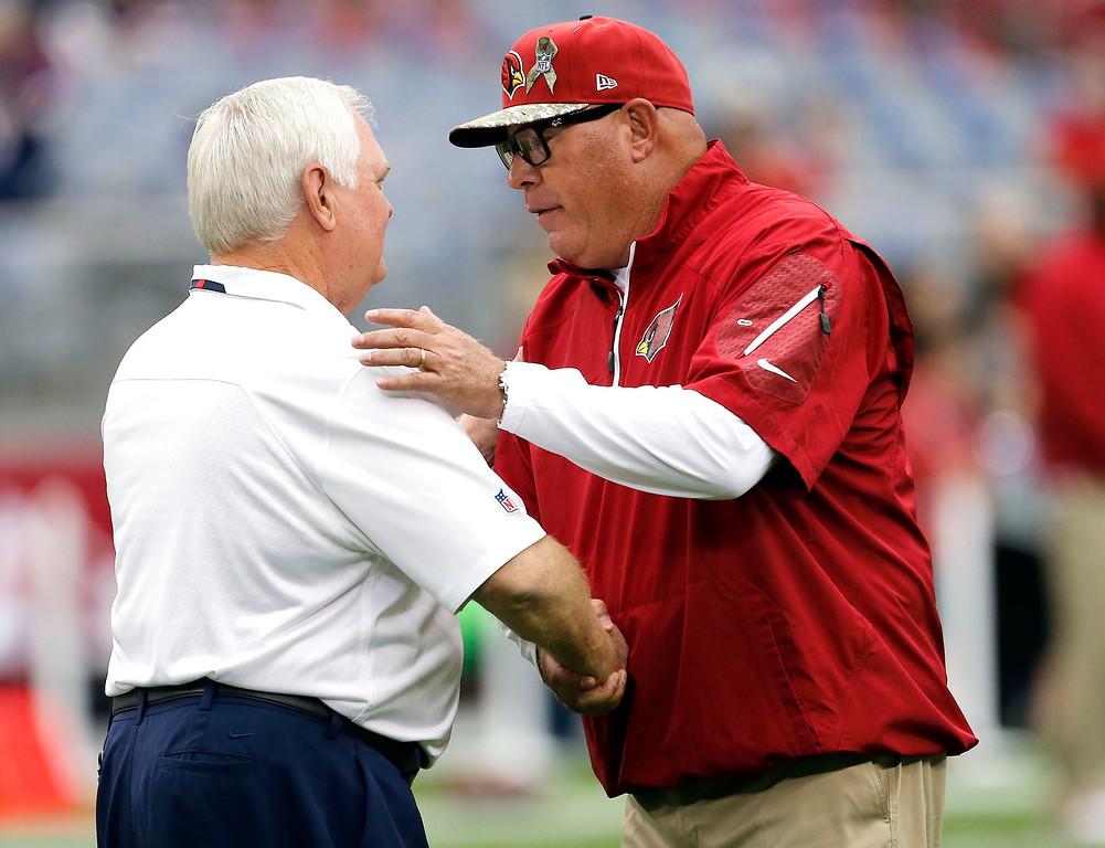 . Arizona Cardinals head coach Bruce Arians, right, greets Houston Texans interim head coach Wade Phillips before an NFL football game on Sunday, Nov. 10, 2013, in Glendale, Ariz. (AP Photo/Matt York)