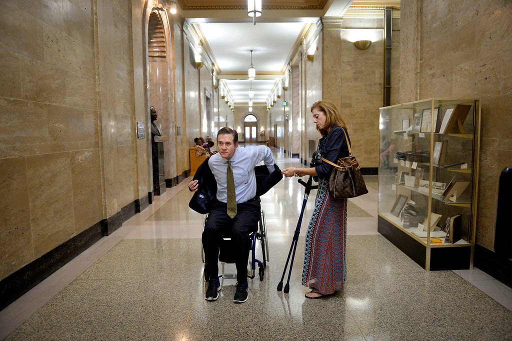 . Kyle prepares to enter the courtroom with his wife Leann. Kyle\'s progress had him using canes sometimes, a wheelchair at others. He believed first impressions were a key to his credibility as a court expert, so he preferred to walk in on canes instead of using the chair. (Photo By Craig F. Walker / The Denver Post)