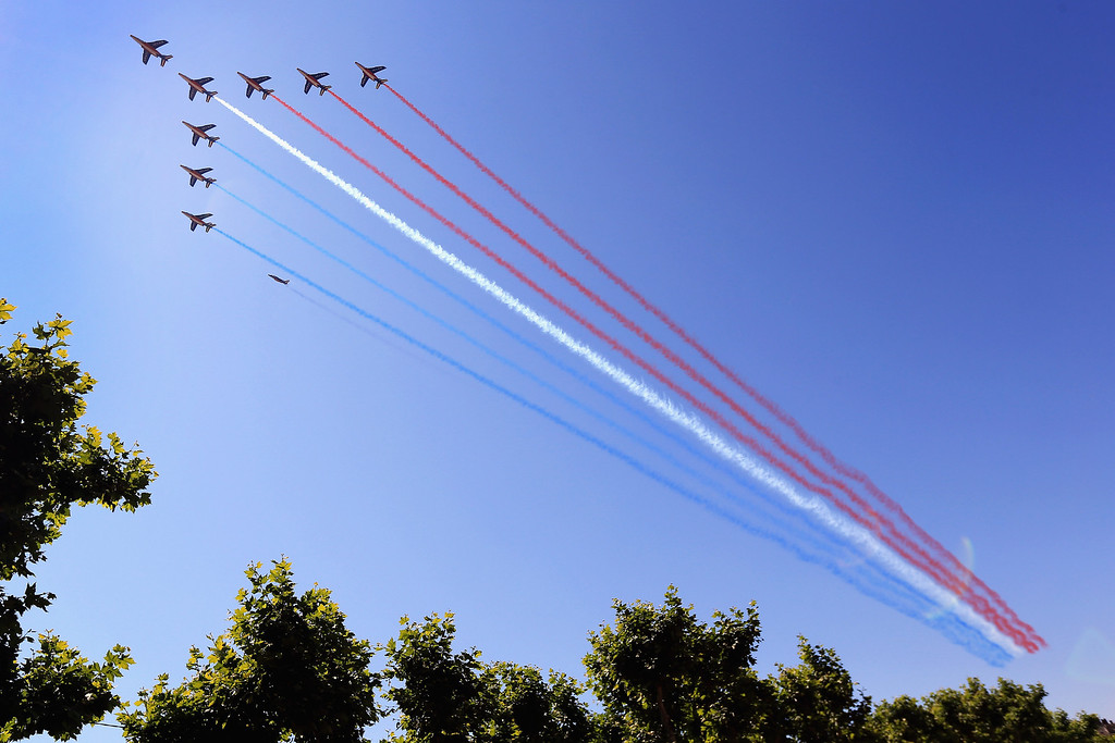 . The French Airforce paints the sky red white and blue prior to stage two of the 2013 Tour de France, a 156KM road stage from Bastia to Ajaccio, on June 30, 2013 in Bastia, France. The 100th edition of Le Tour de France commences on the island of Corsica and ends July 21 in Paris.  (Photo by Doug Pensinger/Getty Images)