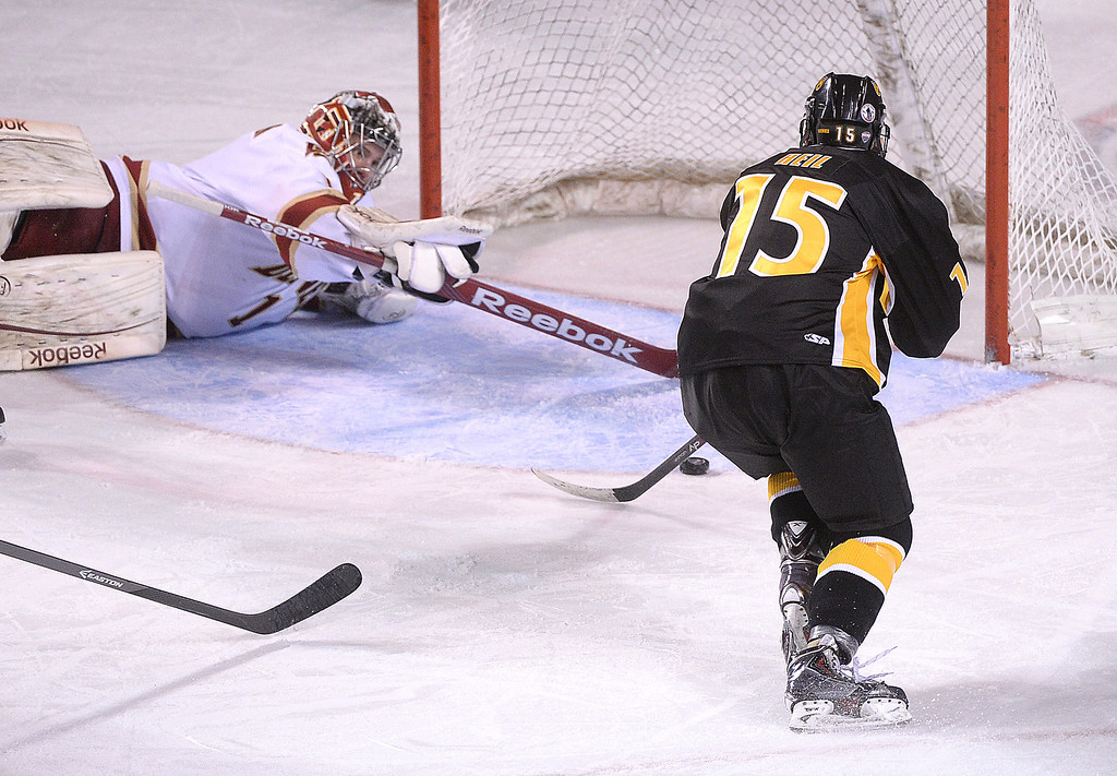 . DENVER, CO. - FEBRUARY 21, 2014: With Denver goalie Sam Brittain down and out of position Tigers\' center Christian Heil (15) had an open shot on net in the third period. The Colorado College hockey team defeated Denver 3-2 at Magness Arena Friday night, February 21, 2014. Photo By Karl Gehring/The Denver Post