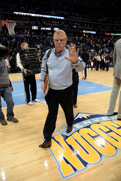 . DENVER, CO - APRIL 16: Long time Denver Nuggets trainer Jim Gillen walks off the court for the last time as he will retire April 16, 2014 at Pepsi Center. Gillen served as trainer for the team for 23 seasons. Golden State Warriors defeated the Denver Nuggets 116-112. (Photo by John Leyba/The Denver Post)