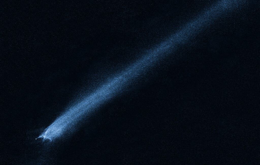 . This image provided by NASA Tuesday Feb. 2, 2010 shows a mystery object that was discovered on Jan. 6, 2010, by the Lincoln Near-Earth Asteroid Research (LINEAR) sky survey. The object appears so unusual in ground-based telescopic images that discretionary time on NASA\'s Hubble Space Telescope was used to take this close-up look. The observations show a bizarre X-pattern of filamentary structures near the point-like nucleus of the object and trailing streamers of dust. This complex structure suggests the object is not a comet but instead the product of a head-on collision between two asteroids traveling five times faster than a rifle bullet. Astronomers have long thought that the asteroid belt is being ground down through collisions, but such a smashup has never before been seen. (AP Photo/NASA)