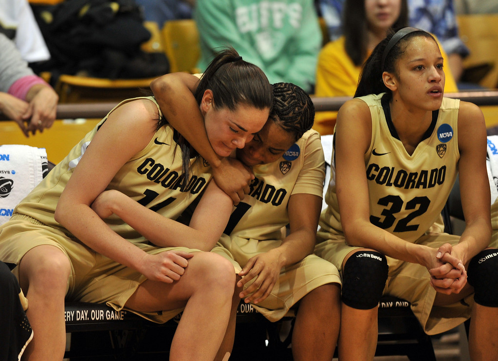 . BOULDER, CO. - MARCH 23: Brittany Wilson (11), center, comforts Meagan Malcolm-Peck (14), left, by Arielle Roberson (32) of Colorado Buffaloes in the end of the first round of the 2013 NCAA women\'s Basketball Tournament game against Kansas Jayhawks at Coors Events Center. Boulder, Colorado. March 23, 2013. Kansas won 67-52. (Photo By Hyoung Chang/The Denver Post)