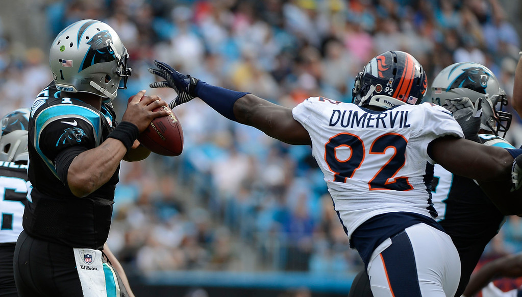 . Denver Broncos defensive end Elvis Dumervil (92) reaches out to force a fumble on Carolina Panthers quarterback Cam Newton (1) during the first quarter Sunday, November 12, 2012 at Bank of America Stadium.  John Leyba, The Denver Post