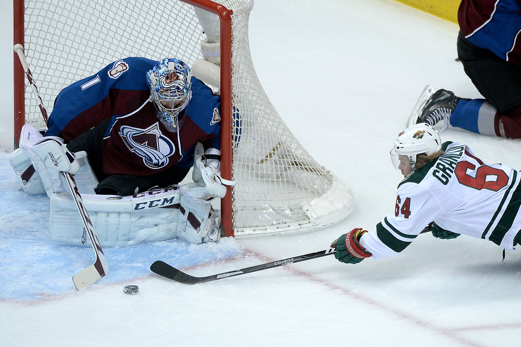 . DENVER, CO - APRIL 26: Mikael Granlund (64) of the Minnesota Wild takes a shot on Semyon Varlamov (1) of the Colorado Avalanche that would be stopped during the first period. The Colorado Avalanche hosted the Minnesota Wild during game five of the first round of the NHL Stanley Cup Playoffs at the Pepsi Center on Saturday, April 26, 2014. (Photo by Karl Gehring/The Denver Post)