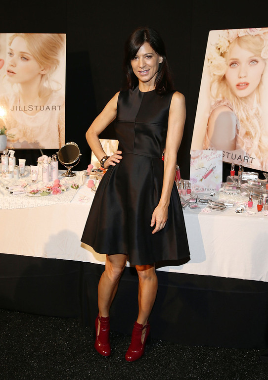 . Actress Perrey Reeves backstage at the Jill Stuart fashion show during Mercedes-Benz Fashion Week Spring 2014 at The Stage at Lincoln Center on September 7, 2013 in New York City.  (Photo by Neilson Barnard/Getty Images for Mercedes-Benz Fashion Week 2014)