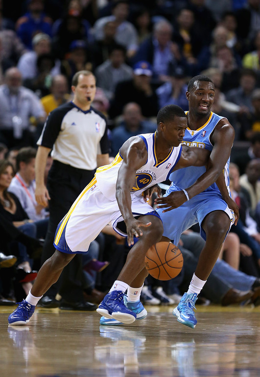 . OAKLAND, CA - NOVEMBER 29: Harrison Barnes #40 of the Golden State Warriors tries to dribble around Jordan Hamilton #1 of the Denver Nuggets at Oracle Arena on November 29, 2012 in Oakland, California.  (Photo by Ezra Shaw/Getty Images)