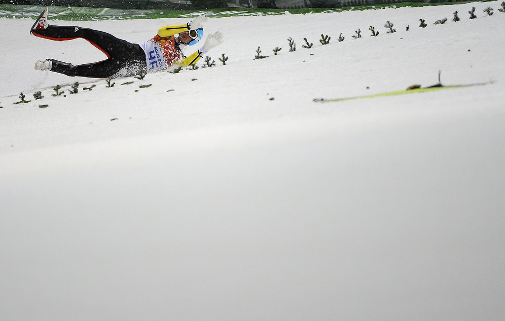 . Germany\'s Severin Freund crashes as he competes in the Men\'s Ski Jumping Normal Hill Individual Final Round trial at the RusSki Gorki Jumping Center during the Sochi Winter Olympics on February 9, 2014 in Rosa Khutor.  PIERRE-PHILIPPE MARCOU/AFP/Getty Images