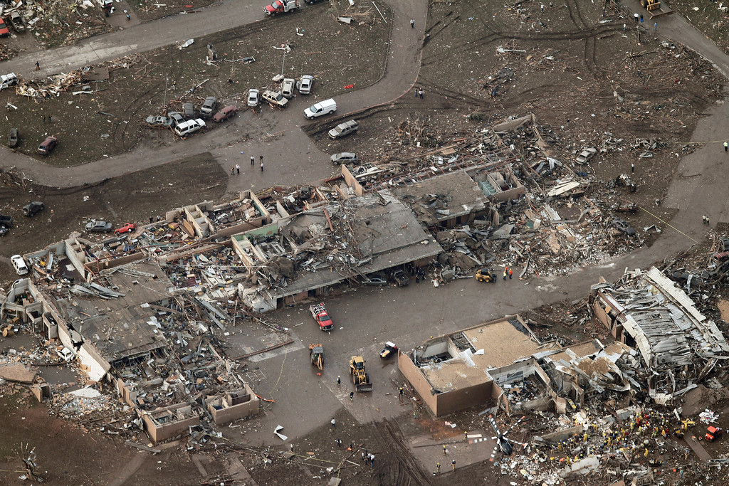 . This aerial photo shows damage to Plaza Towers Elementary School after it was hit by a massive tornado in Moore, Okla., Monday May 20, 2013. A tornado roared through the Oklahoma City suburbs Monday, flattening entire neighborhoods, setting buildings on fire and landing a direct blow on an elementary school. (AP Photo/Steve Gooch)