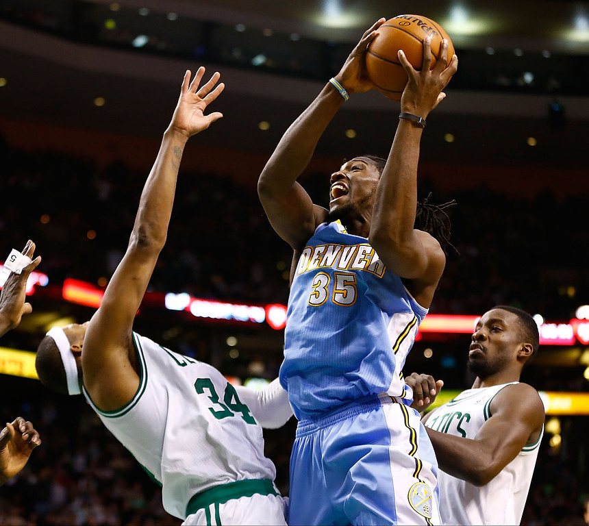 . BOSTON, MA - FEBRUARY 10: Kenneth Faried #35 of the Denver Nuggets drives to the basket in front of Paul Pierce #34 and Jeff Green #8 of the Boston Celtics during the game on February 10, 2013 at TD Garden in Boston, Massachusetts.  (Photo by Jared Wickerham/Getty Images)