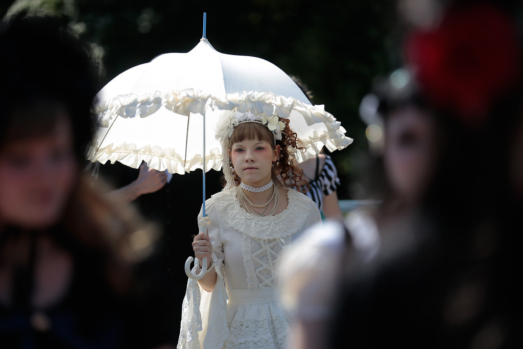 . Participants of the \'Victorian Picnic\'  arrive at the Wave Gothic Festival in Leipzig, central Germany, Friday, June 6, 2014.   (AP Photo/Markus Schreiber)