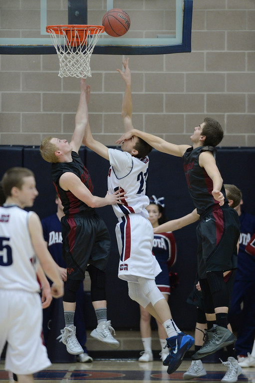 . LITTLETON, CO. - JANUARY 17: Dakota Ridge point Ian MacDonald (21) got a hand in the face going to the basket in the second half. The Dakota Ridge High School boy\'s basketball team hung on to beat Chatfield 53-51 Friday night, January 17, 2014. Photo By Karl Gehring/The Denver Post
