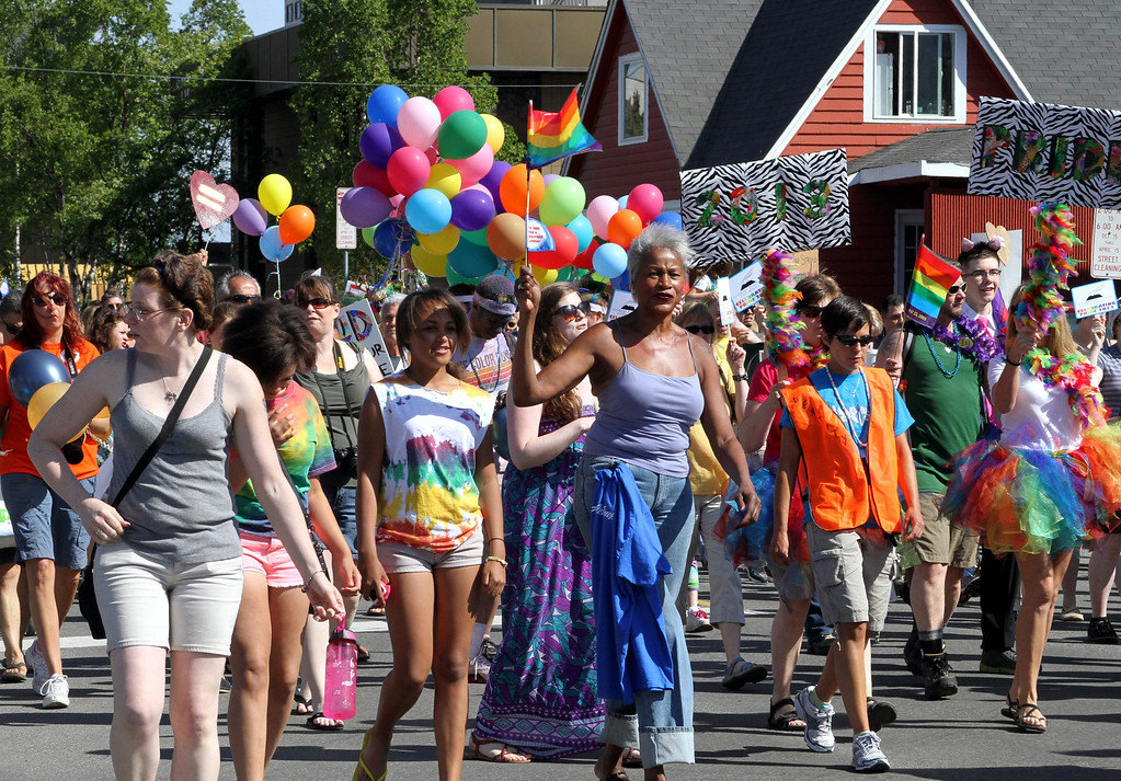 . Participants in the Alaska Pride March walk in downtown Anchorage, Alaska, on Saturday, June 15, 2013. Instead of  parade, a unity march was held from downtown to the Alaska Pride Festival on the Delaney Park Strip. (AP Photo/Mark Thiessen)