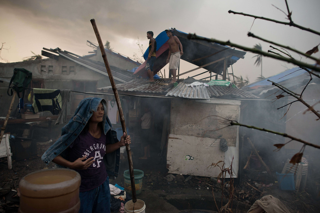 . A typhoon victim stand outside her temporary shack in Palo on November 21, 2013.  AFP PHOTO/ Nicolas ASFOURI/AFP/Getty Images