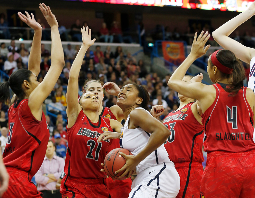 . Connecticut forward Morgan Tuck (3) tries to shoot against Connecticut defense during first half of the national championship game of the women\'s Final Four of the NCAA college basketball tournament, Tuesday, April 9, 2013, in New Orleans. (AP Photo/Dave Martin)