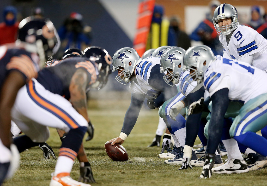 . The Chicago Bears and the Dallas Cowboys line up during a game at Soldier Field on December 9, 2013 in Chicago, Illinois.  (Photo by Jonathan Daniel/Getty Images)