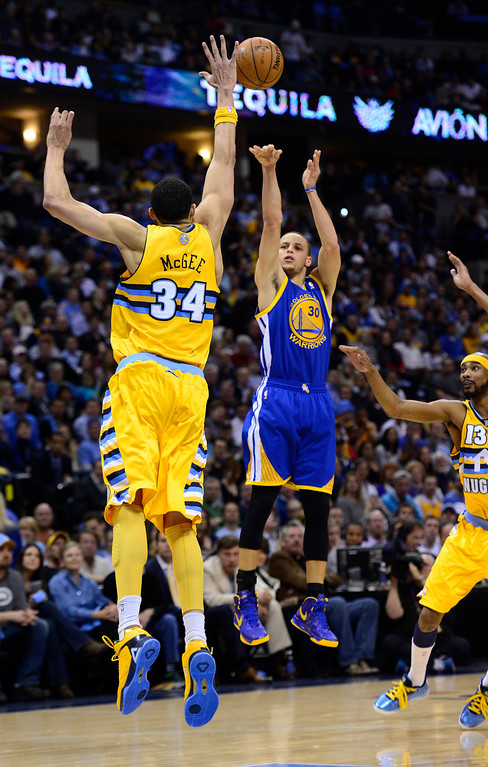 . DENVER, CO. - APRIL 23: Golden State Warriors point guard Stephen Curry (30) takes a shot over Denver Nuggets center JaVale McGee (34) in the second quarter. The Denver Nuggets took on the Golden State Warriors in Game 2 of the Western Conference First Round Series at the Pepsi Center in Denver, Colo. on April 23, 2013. (Photo by AAron Ontiveroz/The Denver Post)