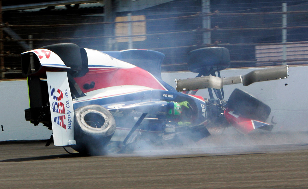 . The car driven by Conor Daly slide down the track after hitting the wall in the first turn during practice for the Indianapolis 500 auto race at the Indianapolis Motor Speedway in Indianapolis, Thursday, May 16, 2013. Daly was not injured. (AP Photo/Joe Watts)