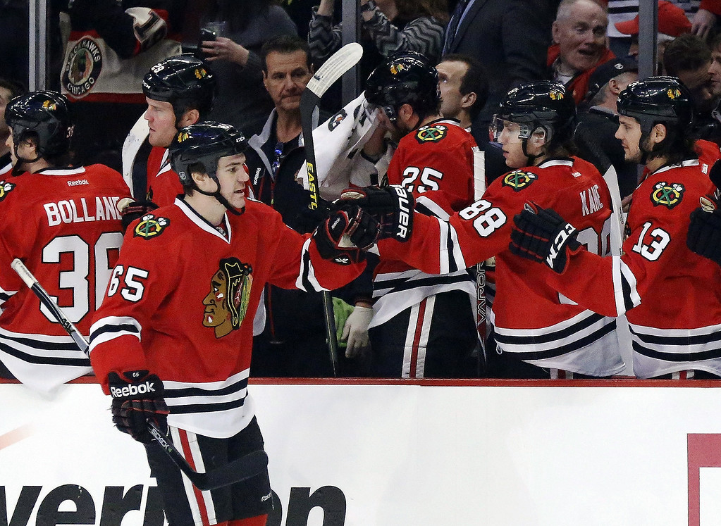 . Chicago Blackhawks center Andrew Shaw celebrates his goal with teammates on the bench during the first period of an NHL hockey game against the Colorado Avalanche, Wednesday, March 6, 2013, in Chicago. (AP Photo/Charles Rex Arbogast)