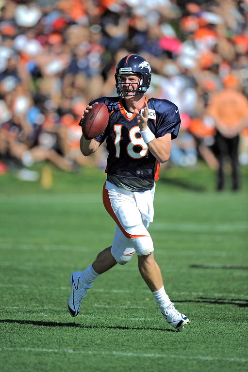 . Denver Broncos Peyton Manning (18) looks to pass during training camp August 13, 2013 at Dove Valley. (Photo By John Leyba/The Denver Post)