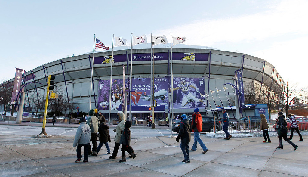 . Fans walk outside the Mall of America Field at the Hubert H. Humphrey Metrodome before an NFL football game between the Minnesota Vikings and the Detroit Lions, Sunday, Dec. 29, 2013, in Minneapolis. The Vikings are playing their final game in the Metrodome, as it will be torn down following the season. (AP Photo/Ann Heisenfelt)