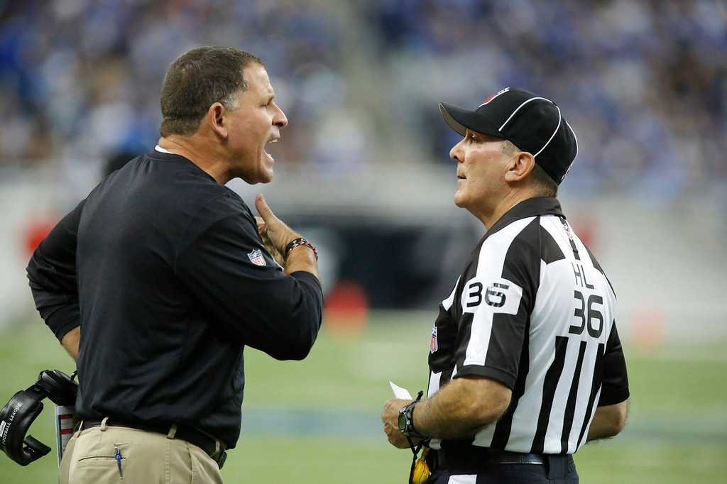 . Tampa Bay Buccaneers head coach Greg Schiano, left, argues a call with head linesman Tony Veteri (36) during the second quarter of an NFL football game against the Detroit Lions at Ford Field in Detroit, Sunday, Nov. 24, 2013. (AP Photo/Duane Burleson)