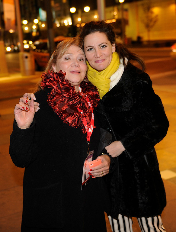 . DENVER, CO. - NOVEMBER 6: Lisa Gilford, left, posed with her daughter Molly, right, outside the Ellie Caulkins Opera House as the 36th Starz Film Festival opened Wednesday night, November 6, 2013 with a showing of the movie Labor Day. Photo By Karl Gehring/The Denver Post