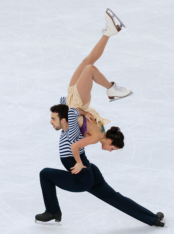 . Sara Hurtado and Adria Diaz of Spain compete in the ice dance free dance figure skating finals at the Iceberg Skating Palace during the 2014 Winter Olympics, Monday, Feb. 17, 2014, in Sochi, Russia. (AP Photo/Ivan Sekretarev)
