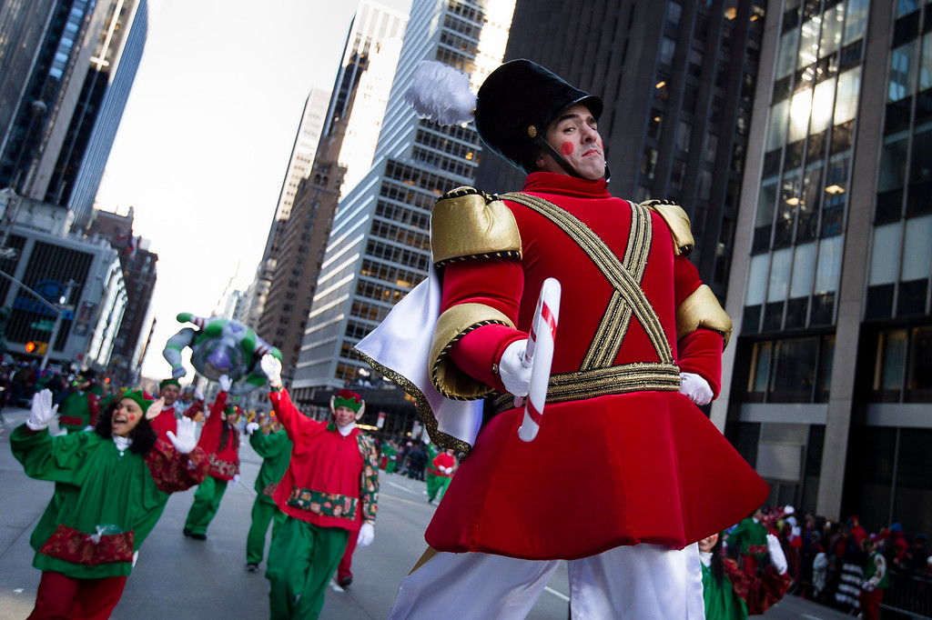 . A performer dressed as a nutcracker poses for a photograph as he marches down 6th Avenue during the 87th Annual Macy\'s Thanksgiving Day Parade, Thursday, Nov. 28, 2013, in New York. After fears the balloons could be grounded if sustained winds exceeded 23 mph, Snoopy, Spider-Man and the rest of the iconic balloons received the all-clear from the New York Police Department to fly between Manhattan skyscrapers on Thursday. (AP Photo/John Minchillo)