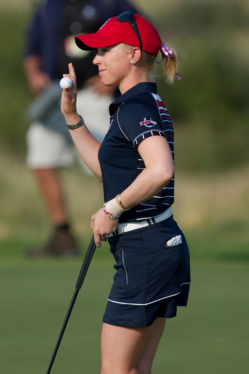 . PARKER, CO - AUGUST 16: American Morgan Pressel waves to the crowd after sinking a putt on the second hole during the first day of the Solheim Cup at Colorado Golf Club, on August 16, 2013.  (Photo By Grant Hindsley/The Denver Post)