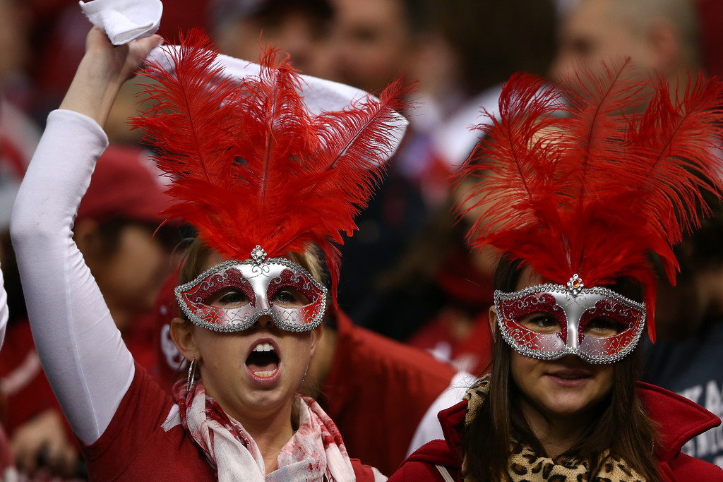 . NEW ORLEANS, LA - JANUARY 02:  Fans cheer during the Allstate Sugar Bowl at the Mercedes-Benz Superdome on January 2, 2014 in New Orleans, Louisiana.  (Photo by Streeter Lecka/Getty Images)