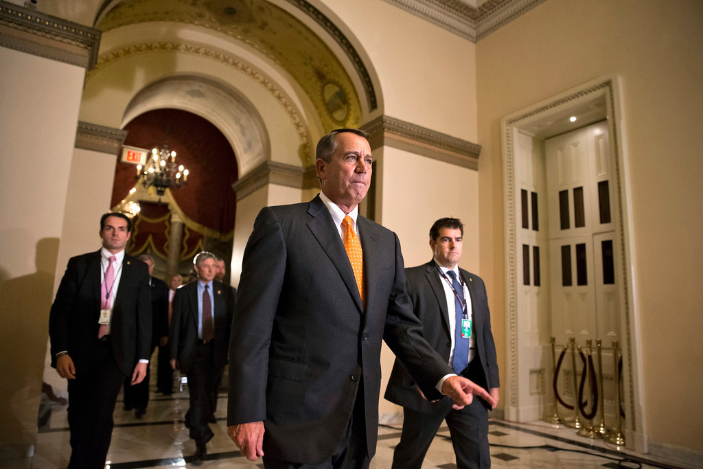 . Speaker of the House John Boehner, R-Ohio, walks to the chamber for the vote on a Senate-passed bill that would avert a threatened Treasury default and reopen the government after a partial, 16-day shutdown, at the Capitol in Washington, Wednesday, Oct. 16, 2013. The end to the rancorous standoff between the Democratic-controlled Senate and the Republican-controlled House was hastened by the imminent deadline to extend the debt ceiling to avoid a national default. (AP Photo/J. Scott Applewhite)