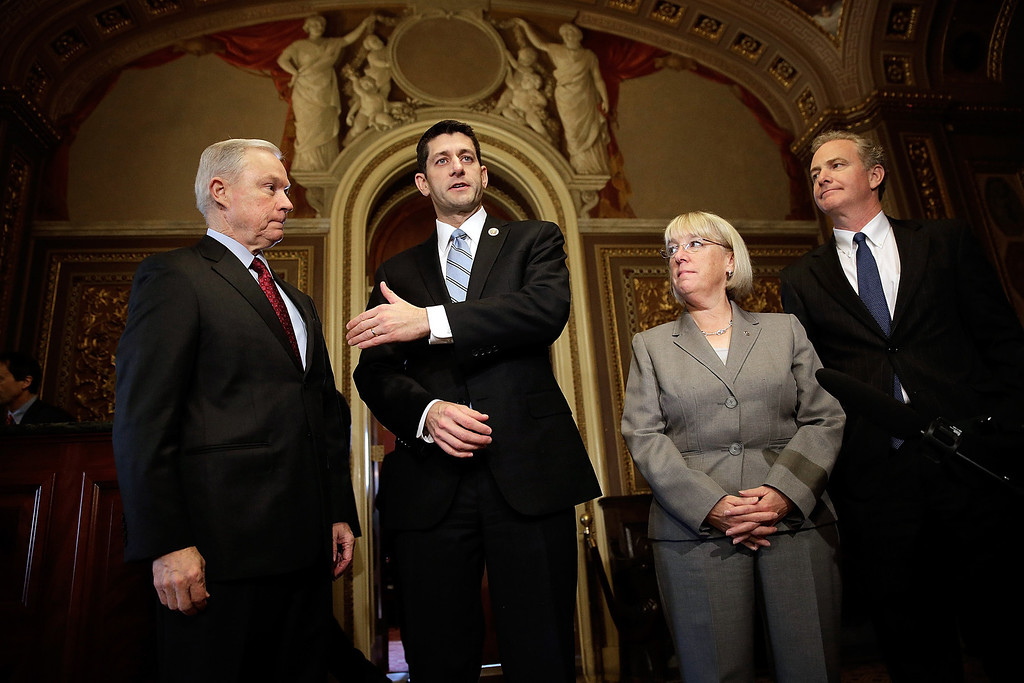 . Members of the bipartisan budget conference (L-R) Sen. Jeff Sessions (R-AL), Rep. Paul Ryan (R-WI), Sen. Patty Murray (D-WA) and Rep. Chris Van Hollen (D-MD) discuss their initial meeting at the U.S. Capitol October 17, 2013 in Washington, DC. Congress voted last night to fund the federal budget and increase the nation\'s debt limit, ending a 16-day government shutdown.  (Photo by Win McNamee/Getty Images)