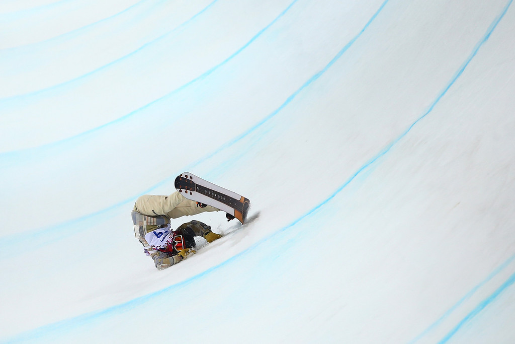 . Danny Davis of the United States crashes out in the Snowboard Men\'s Halfpipe Finals on day four of the Sochi 2014 Winter Olympics at Rosa Khutor Extreme Park on February 11, 2014 in Sochi, Russia.  (Photo by Al Bello/Getty Images)