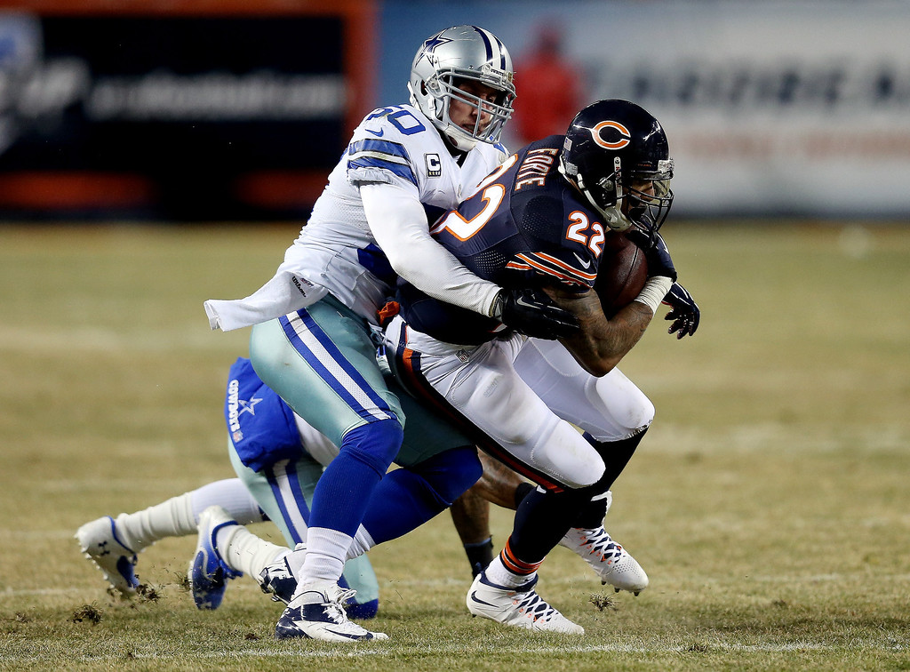 . Running back Matt Forte #22 of the Chicago Bears is tackled by middle linebacker Sean Lee #50 of the Dallas Cowboys during a game at Soldier Field on December 9, 2013 in Chicago, Illinois.  (Photo by Jonathan Daniel/Getty Images)