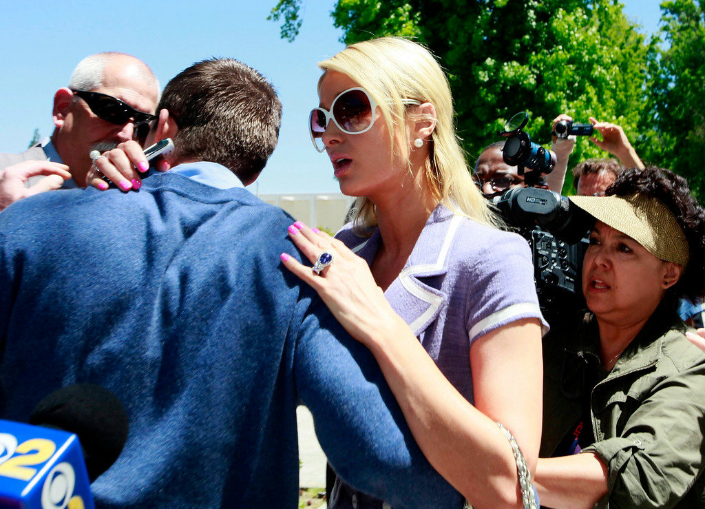 . In this April 27, 2011 file photo, Paris Hilton, center, reacts as she comforts her boyfriend Cy Waits, left after Waits was grabbed by an unknown assailant as he and Hilton were walking into court in Los Angeles. Hilton and her then-boyfriend Waits were accosted by James Rainford while they walked in to a courthouse to testify against another man who had broken in to the hotel heiress\' Hollywood Hills home. Hilton\'s security wrestled Rainford to the ground and he was promptly arrested him and he pleaded no contest to misdemeanor battery. Rainford, who was repeatedly arrested outside Hilton\'s residences and asked her to marry him, was ultimately charged with felony stalking and sentenced to probation and psychiatric counseling in April 2012. (AP Photo/Nick U, file)