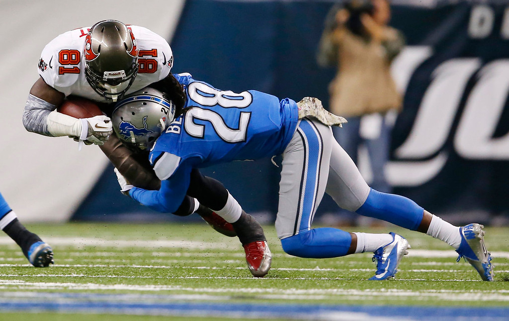 . Tampa Bay Buccaneers tight end Timothy Wright (81) is stopped by Detroit Lions cornerback Bill Bentley (28) during the second quarter of an NFL football game at Ford Field in Detroit, Sunday, Nov. 24, 2013. (AP Photo/Paul Sancya)