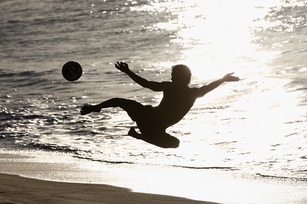 . A local boy shows off his beach soccer skills on Magna Praia beach on June 11, 2014 in Fortaleza, Brazil.  (Photo by Michael Steele/Getty Images)