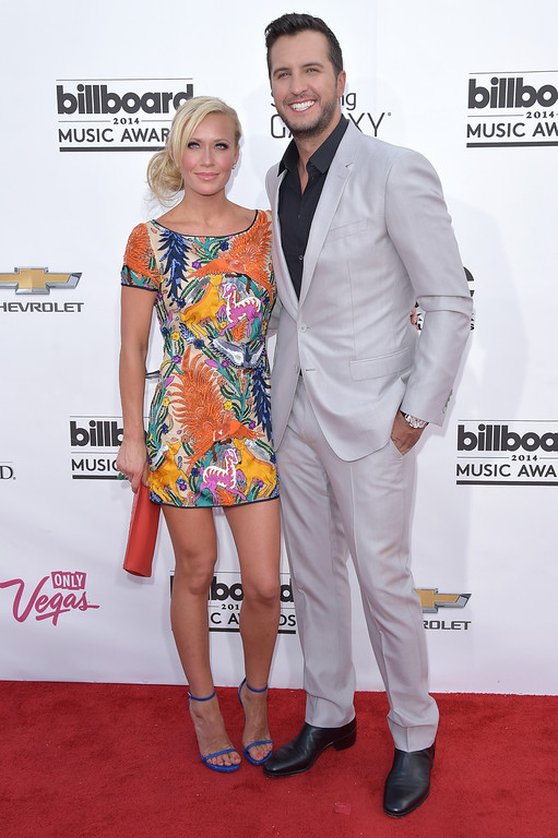 . Caroline Boyer, left, and Luke Bryan arrive at the Billboard Music Awards at the MGM Grand Garden Arena on Sunday, May 18, 2014, in Las Vegas. (Photo by John Shearer/Invision/AP)