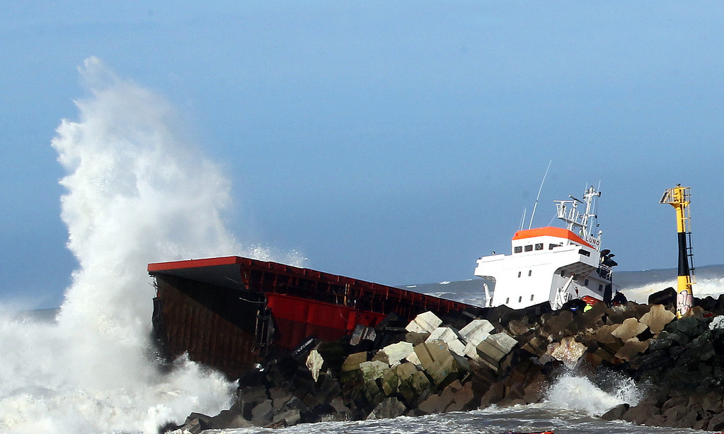 ". Waves knock against the wreck of the Spanish cargo ship ""Luno\"" that slammed into a jetty in choppy Atlantic Ocean waters and broke in two, off Anglet, southwestern France, Wednesday, Feb. 5, 2014.  (AP Photo/Bob Edme)"