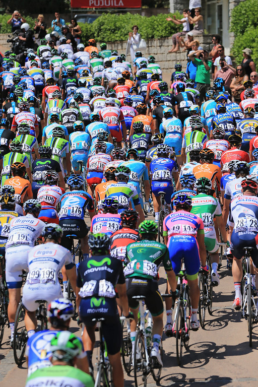 . General view of the peloton as they leave the start of stage one of the 2013 Tour de France, a 213KM road stage from Porto-Vecchio to Bastia, on June 29, 2013 in Porto Vecchio, France.  (Photo by Doug Pensinger/Getty Images)