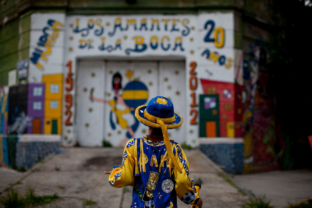 ". Damian Carballo, a member of the murga ""Los amantes de La Boca,\"" walks at the La Boca neighborhood before participating in carnival celebrations in Buenos Aires, Argentina, Saturday, Feb. 2, 2013.  (AP Photo/Natacha Pisarenko)"