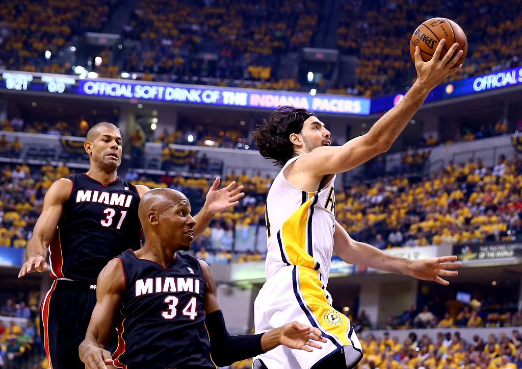 . INDIANAPOLIS, IN - MAY 28: Luis Scola #4 of the Indiana Pacers goes to the basket as Ray Allen #34 of the Miami Heat defends during Game Five of the Eastern Conference Finals of the 2014 NBA Playoffs at Bankers Life Fieldhouse on May 28, 2014 in Indianapolis, Indiana.  (Photo by Andy Lyons/Getty Images)