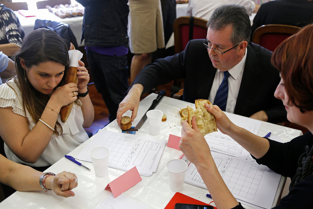. Jury members taste and select baguettes, French bread, which compete for the \'Grand Prix de la Baguette de la Ville de Paris\' (Best Baguette of Paris 2013) annual prize at the Chambre Professionnelle des Artisans Boulangers Patissiers in Paris April 25, 2013. The baguette is a French cultural symbol par excellence and the competition saw 203 Parisian bakers who compete for recognition as finest purveyor of one of France\'s most iconic staples. The baguettes are registered, given anonymous white wrappings and an identification number. They are then carefully weighed and measured to ensure they do not violate the contest\'s strict rules. 52 entries were withdrawn for failing to measure between 55-70cm long or not matching the acceptable weight of between 250-300g. Every year, the winner earns the privilege of baking bread for the French President.   REUTERS/Charles Platiau