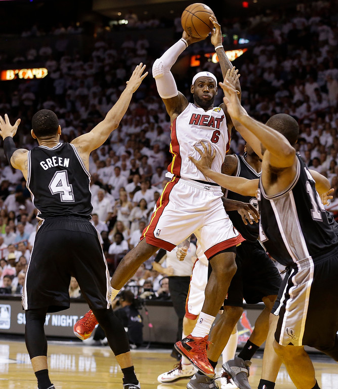 . The Miami Heat\'s LeBron James (6) shoots against San Antonio Spurs\' Danny Green (4) during the second half in Game 7 of the NBA basketball championships, Thursday, June 20, 2013, in Miami. (AP Photo/Lynne Sladky)